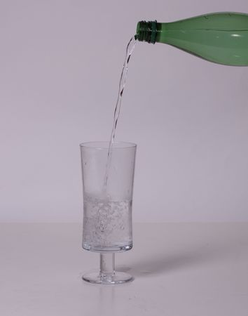 Sparkling Water Being Poured in Glass Stock Photo