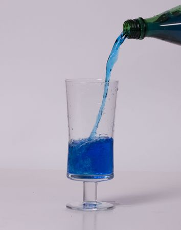 Blue Drink Being Poured in Glass