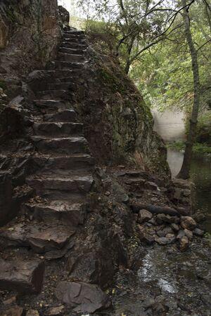 Steep carved rock stairs Stok Fotoğraf