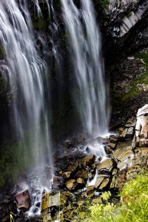 Twin Falls desend into a shallow, rocky stream.
