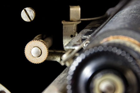 A Relic: An Outer Space Wannabe. Abstract of the gears and screws of a 1940s typewriter that seems to float in the blackness of space. Suitable for multiple business and industrial applications; business office, hotel and motel wall decoration. Reklamní fotografie