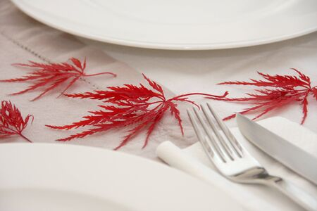 Pure autumn table setting with japanese maple