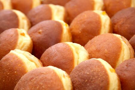 Many fresh homemade Austrian Carnival Donuts so called Austrian Faschingskrapfen or Berliner sweet Krapfen filled with apricot jam close up