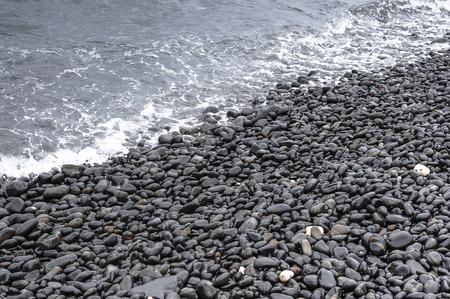 black pebbles: Black Pebbles on Sea Beach
