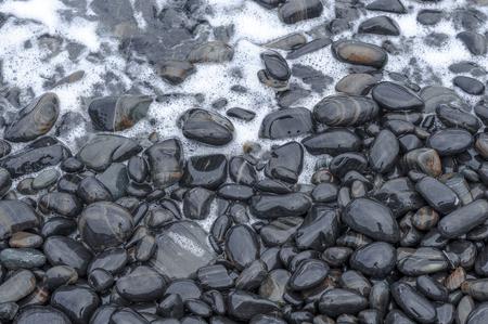 black pebbles: Black Pebbles with wave on Sea Beach