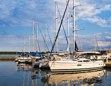 Docked luxury yachts at sunset Фото со стока - 5563257
