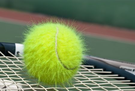 Shaggy tennis ball on a racquet