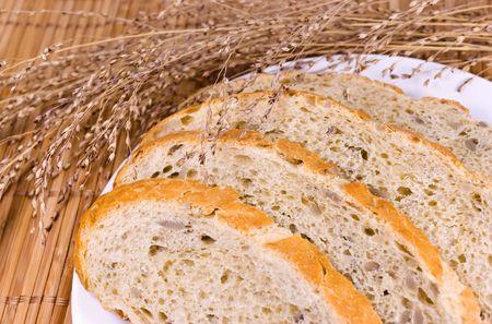 Golden sliced bread on white plate