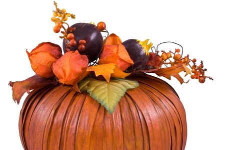 Orange decorative pumpkin with leaves, flowers and berries