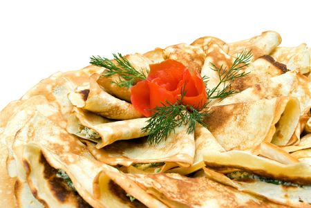 Fresh pancakes stuffed with feta cheese and spinach and decorated with tomato rose and dill