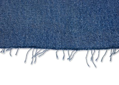 Piece of blue jeans fabric with fringe on white photo
