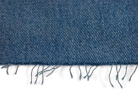 fabric texture: Edge of blue jeans fabric with fringe on white