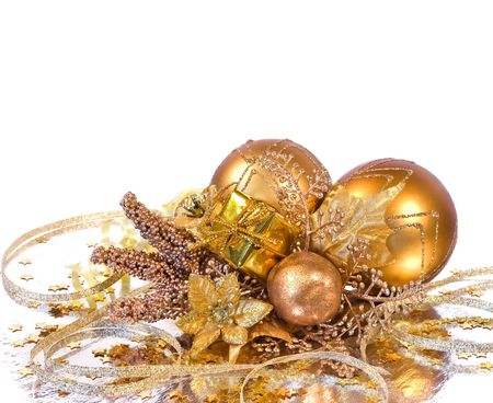 Christmas decoration - golden branch with baubles, flower, gift box and other ornaments