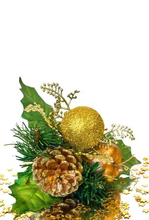 Christmas decoration - green and gold branch with pine cone, baubles, leaves and other ornaments