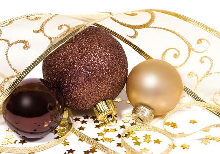 Three gold and bronze baubles decorated with twisted ribbon garlands and stars - christmas decor