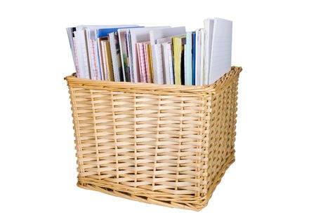 Straw colored wicker basket with textbooks and papers