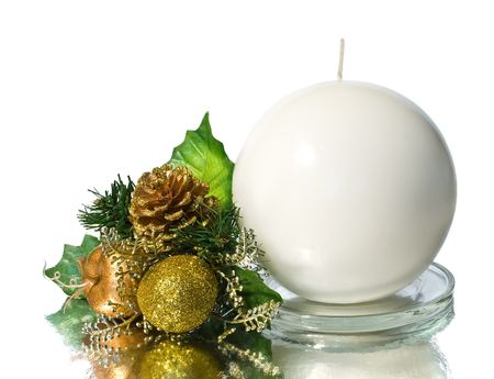 White spherical candle with green and gold christmas decoration photo