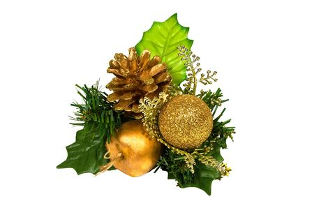 Christmas decoration - green and gold branch with pine cone, bauble, leaves and other ornaments on white Banque d'images