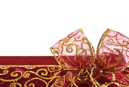 Part of red gift box decorated with sparkled bow and ribbon