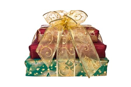 Stack of red and green wrapped gift boxes with gold organza ribbon and bow photo