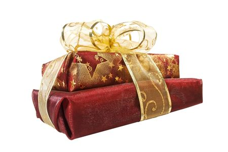 Two organza wrapped red gift boxes decorated with golden ribbon and bow Фото со стока
