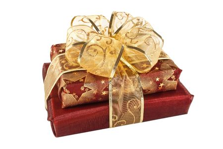 Two wrapped red gift boxes decorated with golden ribbon and bow