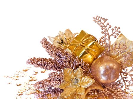 Golden christmas decoration - branch of poinsettia, gift box, berries and apple
