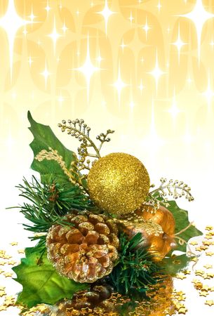 Christmas decoration - green and gold branch with pine cone, bauble, leaves and other ornaments