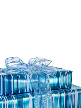 Blue glossy gift boxes decorated with a ribbon - vertical Фото со стока