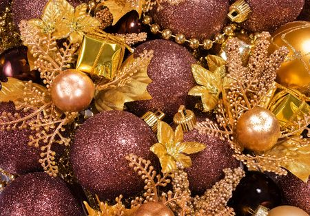 Golden and bronze christmas background - baubles, gift boxes, poinsettia branches, garlands