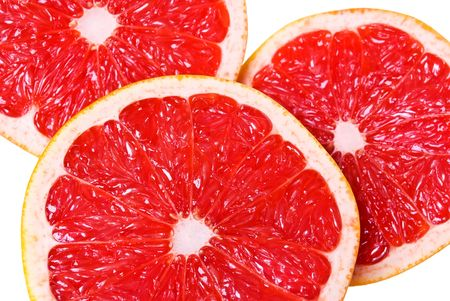 Pink juicy grapefruit slices on white Banque d'images