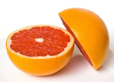 halved  half: Two half pieces of red grapefruit Stock Photo