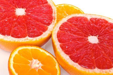 Red grapefruits and mandarines - half pieces