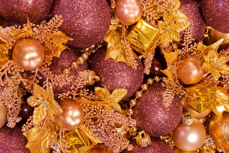 Golden assorted christmas decorations - gift boxes, baubles, garlands