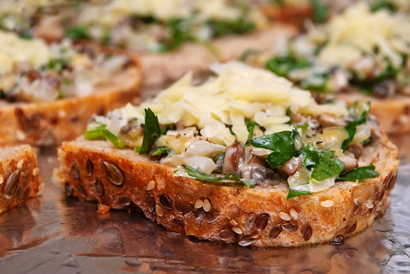 Sandwiches with mushrooms and cheese on whole wheat bread Фото со стока