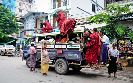 Mandalay, Myanmar - Jan 12, 2015. Many Burmese people on the local bus in Mandalay city, Myanmar. Redakční