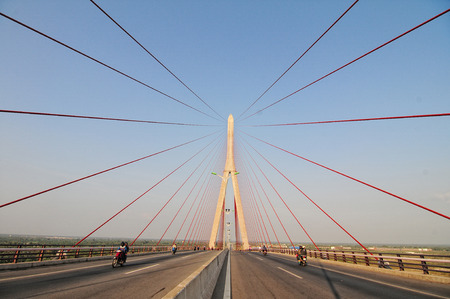 longest: Can Tho, Vietnam - Jan 22, 2014. Can Tho cable-stayed bridge in Can Tho city, Southern of Vietnam, The bridge is currently the longest main span cable-stayed bridge in Southeast Asia. Stock Photo