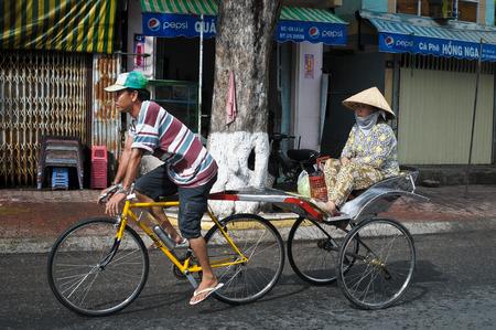 trishaw: CHAU DOC, VIETNAM - SEP 20, 2014. Trishaw on street in Chau Doc town, Vietnam. Trishaws have been around for more than a century in Mekong Delta. Editorial