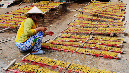 An Giang, Vietnam - Nov 11, 2014. Incense sticks drying on the sun in Mekong Delta, Vietnam. Incense is composed of aromatic biotic materials.