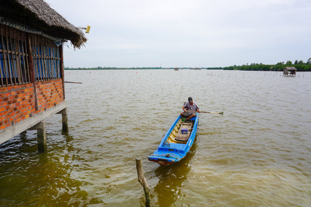Mekong Delta, Vietnam - Aug 22, 2014. Unidentified Vietnamese man sails a boat over the Mekong river. Mekong is the 12th longest river in the world.
