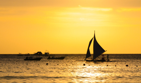 Boats at the sunset, Boracay, Philippines. photo