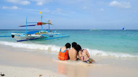 boracay: Boracay, Philippines - Feb 1, 2015. Tourists and traditional boat at White beach, Boracay Island, Philippines.