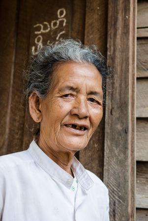 cheroot: Bagan, Myanmar, March 26, 2014. Asiatic old woman in Bagan, Myanmar.