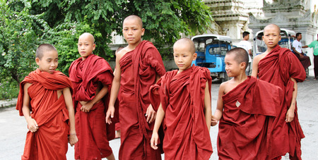ethnology: MANDALAY, MYANMAR - MAY 23, 2014 - Burmese novice boys in Mandalay. Myanmar is the most religious Buddhist country in terms of the proportion of monks in the population. Editorial