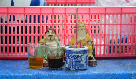 worshipped: BIEN HOA, VIETNAM - APR 6, 2015: The altar of Tu Di Gong, a Chinese earth god worshipped by Chinese folk religion worshippers and Taoists in Vietnam. Editorial
