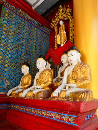travelled: Buddha statue in Burma famous sacred place and tourist attraction landmark - Shwedagon Paya pagoda, Yangon, Myanmar.