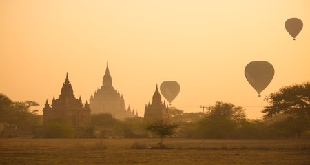 nascent: Scenic sunrise at Bagan, Myanmar. The Bagan Archaeological Zone is a main draw for the countrys nascent tourism industry. It is seen by many as equal in attraction to Angkor Wat in Cambodia.