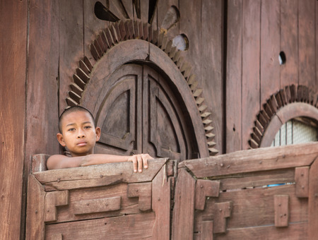 ethnology: MANDALAY, MYANMAR - DECEMBER 8, 2014. An unidentified Burmese Buddhist novice in Mandalay, Myanmar. In 2012 an ongoing conflict started between Buddhists and Muslims in Myanmar.