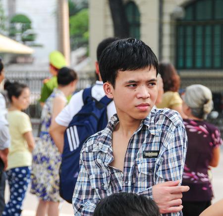 HANOI, VIETNAM - FEB 11, 2015. Portrait of young man on street in Hanoi, Vietnam.