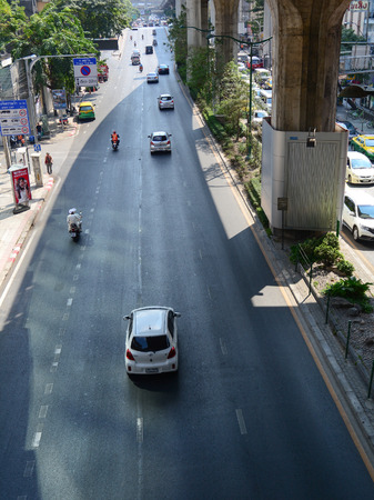 chit: BANGKOK, THAILAND - MARCH 11, 2015. Traffic on the street around Moh Chit BTS station on March 11, 2015. Mo Chit Station is a BTS skytrain station in Chatuchak District, Bangkok, Thailand.